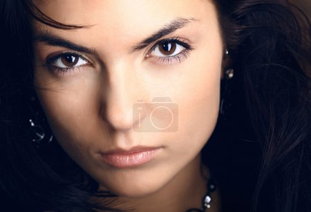 Young beautiful brunette Caucasian girl. Photo....
