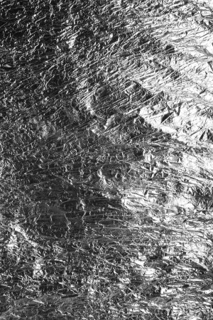 Texture of crumpled foil paper close up
