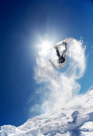 Photo for Snowboarder launching off a jump; La Thuile , Aosta, Italy. - Royalty Free Image