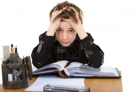 Photo for Child with study of the difficulties on white background - Royalty Free Image