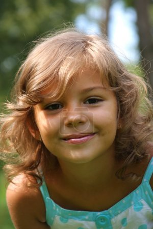Photo for Portrait of the little pretty girl at the meadow - Royalty Free Image