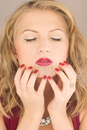 Beauty woman with red nail
