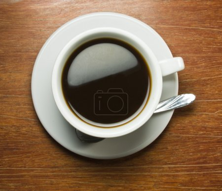Coffeecup with a wooden table