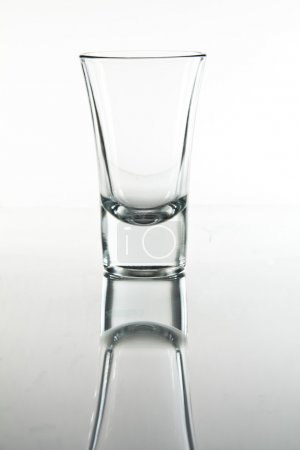 Photo for An empty shot glass on white background. - Royalty Free Image