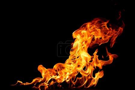 Foto de Fuego sobre un fondo negro - Imagen libre de derechos