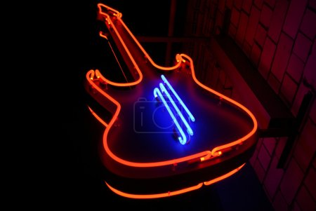 Photo for Neon guitar - symbol of rock cafe - Royalty Free Image