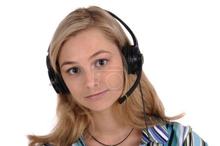 Foto de Joven rubia con auriculares y micrófono aislado en blanco - Imagen libre de derechos