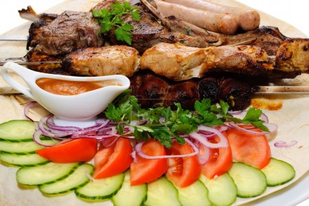 Photo for Grilled meat kebab sausages on pita bread with vegetables - Royalty Free Image