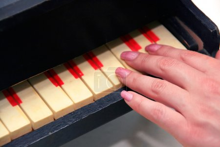 Woman's hands Playing Piano Isolated on
