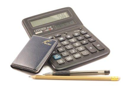 сalculator, notepad, pencil pen