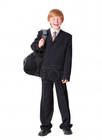 Schoolboy isolated on white