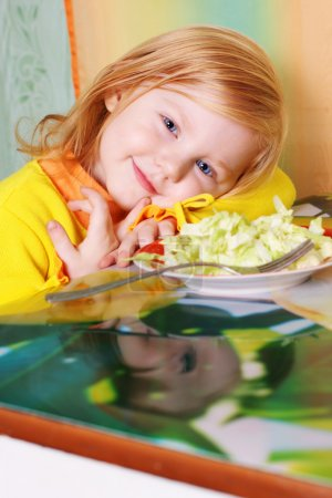 Photo for Little girl witn salad - Royalty Free Image
