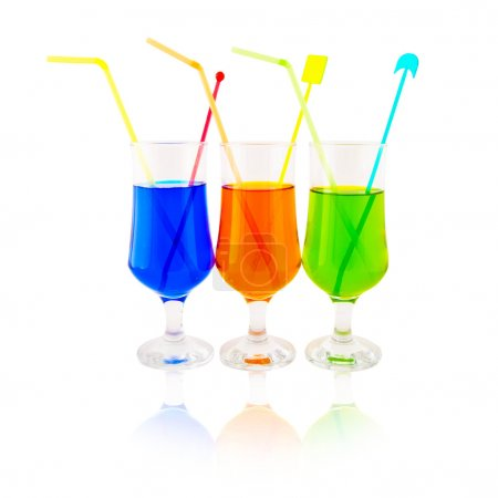 Photo for Multi-colored cocktails in high glasses on a white background - Royalty Free Image