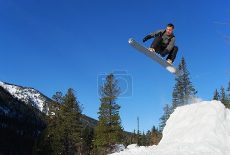 Photo for Gray snowboarder jumping high in the air - Royalty Free Image