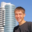 The cheerful teenager on the skyscraper background...