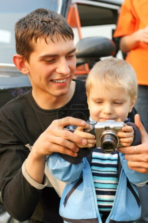 Photo for Little kid and teenager with a camera - Royalty Free Image