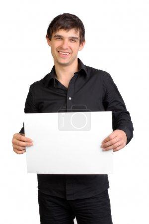 Man holding blank paper