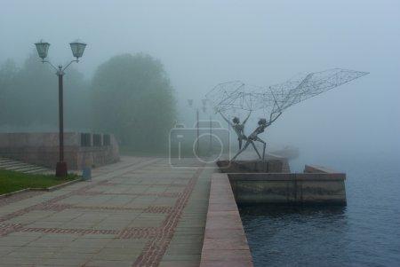 Onega lake embankment in morning fog