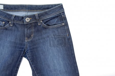 Fragment of jeans on white