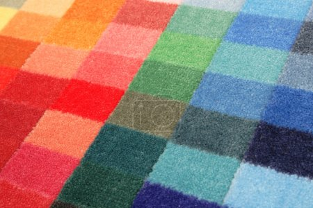 Photo for Color spectrum of carpet samples in row - Royalty Free Image