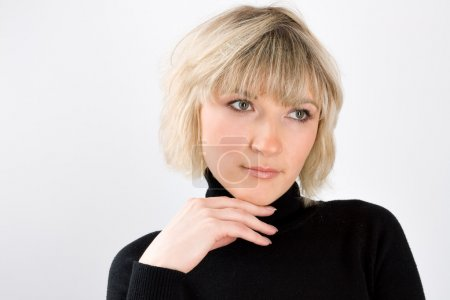 Photo for Portrait of blond woman in black on gray - Royalty Free Image