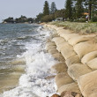 Erosion caused by rising sea levels due to global ...