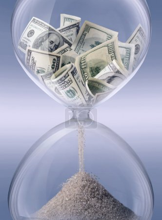 Photo for Time - money. Sand-glass symbolizing business time - Royalty Free Image