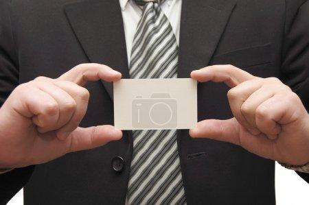 Businessman handing business card