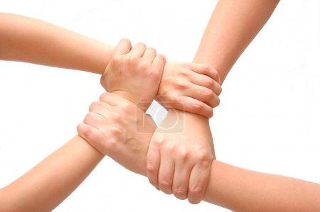 Photo pour Image des mains croisées isolées blanches - image libre de droit