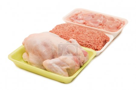 Assortment of crude meat in trays