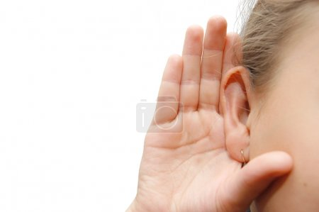 Photo for Girl listening with her hand on an ear - Royalty Free Image