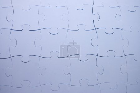 The combined parts of a blue puzzle