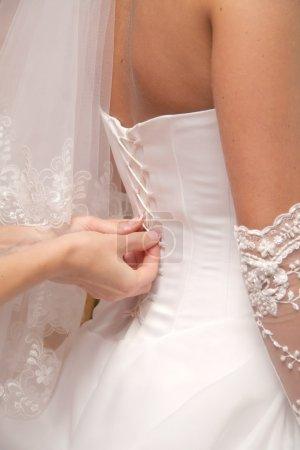 Photo pour Habiller un corset dentelle - image libre de droit