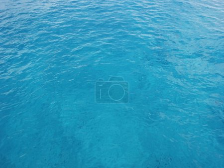 Clear blue ocean water in Cozumel, Mexico. This works great for a background image. Shot on a sunny clear day. You can see the bottom through the clear blue