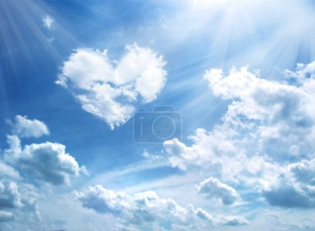 Photo for Heart in a blue unflawed sky in the form of clouds - Royalty Free Image