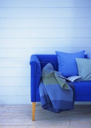 Blue sofa and white brick wall