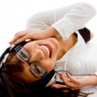 Top view of smiling female enjoying music on an is...