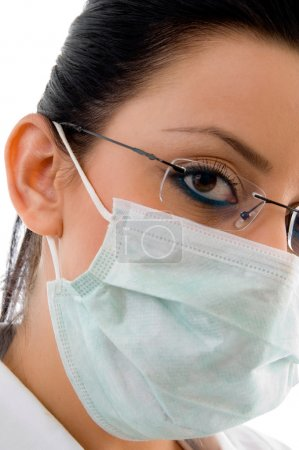 Close view of doctor wearing mask