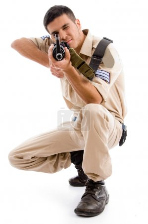 Soldier going to shoot with gun