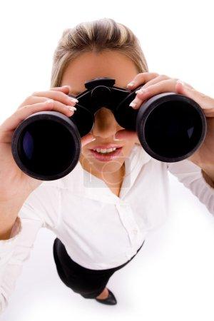 Manager looking through binoculars