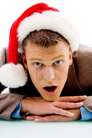 Guy with christmas hat looking at camera