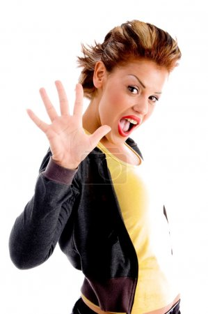 Photo for Pretty woman showing five fingers on an isolated background - Royalty Free Image