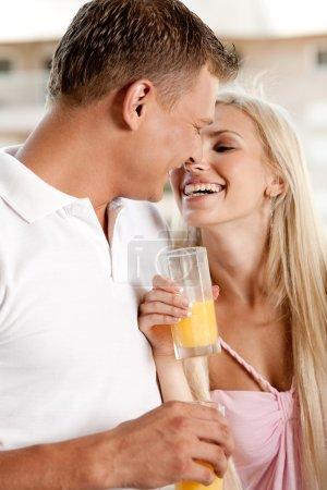 Couple enjoying orange juice