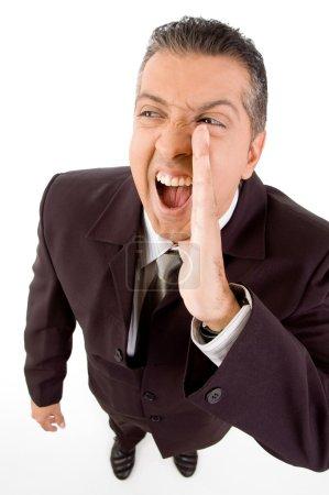 Aged businessman shouting