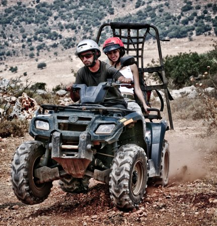 Young couple riding sand buggy