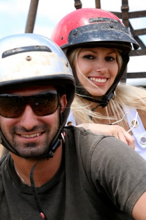 Couple wearing safety helmet, enjoying ride