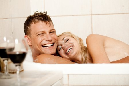 Couple having fun in bath