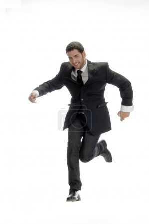 Businessman jumping on one leg