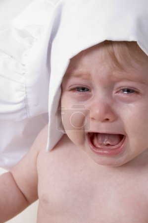 Photo for Portrait of crying little baby chef - Royalty Free Image