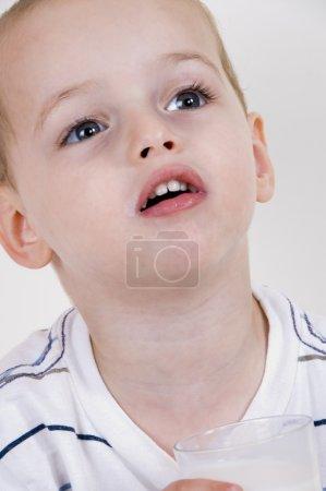 Cute little boy looking upwards